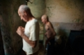 Two elderly brothers in their spacious, but mouldy home in Old Havana